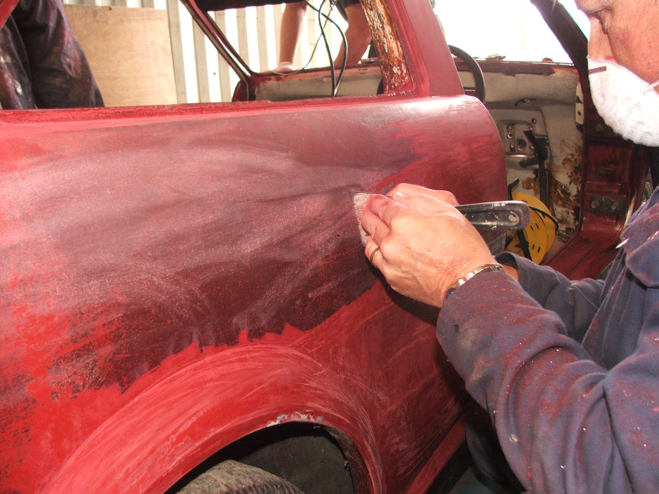 Geoff Ward scraping the paint off Quantum Coupé 003